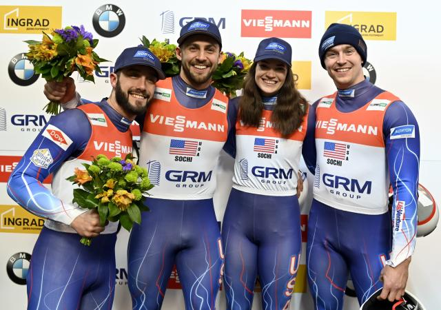 United States's team Jayson Terdiman, left, Chris Mazdzer, second left, Summer Britcher, second right, and Tucker West placed third, celebrate after the relay event at the World Luge Championships in Krasnaya Polyana, near the Black Sea resort of Sochi, southern Russia, Sunday, Feb. 16, 2020. (AP Photo/Artur Lebedev)