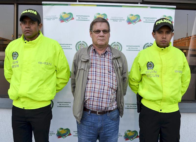 American citizen Russell Martin Stendal (C), seen after being taken into custody, at the headquarters of the Cundinamarca police in Bogota, on February 19, 2015