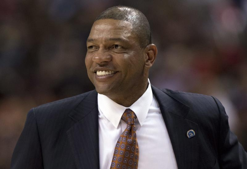 Boston Celtics head coach Doc Rivers smiles during fourth-half NBA basketball game action against the Toronto Raptors in Toronto, Wednesday April 17, 2013. (AP photo/The Canadian Press, Frank Gunn)
