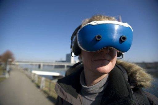 """Jan Torpus tests the immersive """"augmented reality"""" equipment in St Johanns Park in Basel. The project started in 2003, bringing together artists and scientists in the quest for mind-challenging sensations and new ideas for mobile phone apps, electronic maps and smarter websites"""