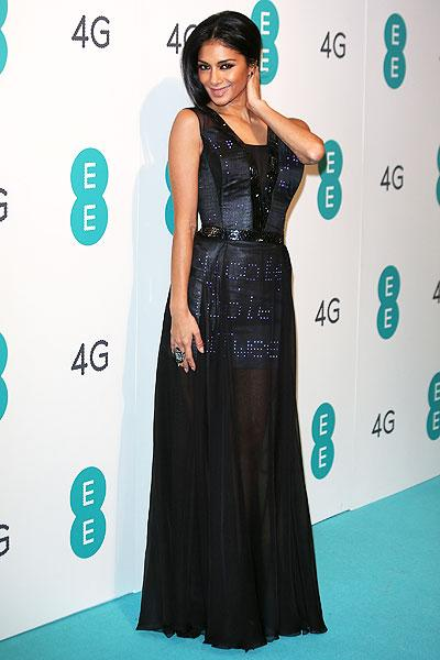 "Nicole shared her enthusiam about the dress on her Twitter account saying ""I've been asked to wear the UK's first ever twitter dress tonight for the @EE Launch Party @BatterseaPowerStation #tweetthedress So EXCITED!"" (Photo by Ferdaus Shamim/WireImage)"