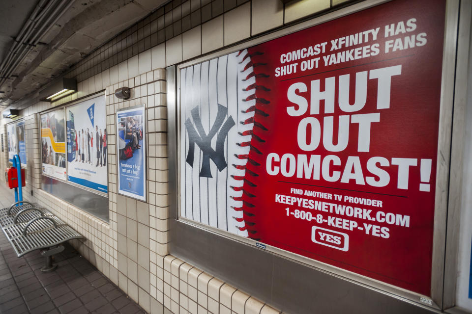 An advertisement by the YES Network in a PATH station in New York on Friday, March 11, 2016 urges viewers to dump Comcast as their cable television provider. The Yankees Entertainment and Sports (YES) network is embroiled in a dispute with cable provider Comcast after Comcast dumped them from their line up in a dispute over viewership. (�� Richard B. Levine) (Photo by Richard Levine/Corbis via Getty Images)