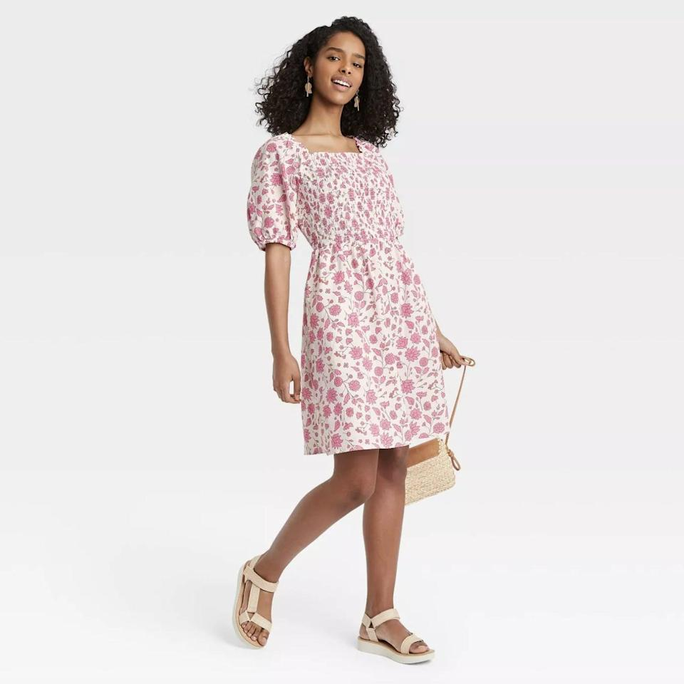 <p>Spend the weekend looking your most effortless <span>Universal Thread Puff Elbow Sleeve Smocked Dress</span> ($25)</p>