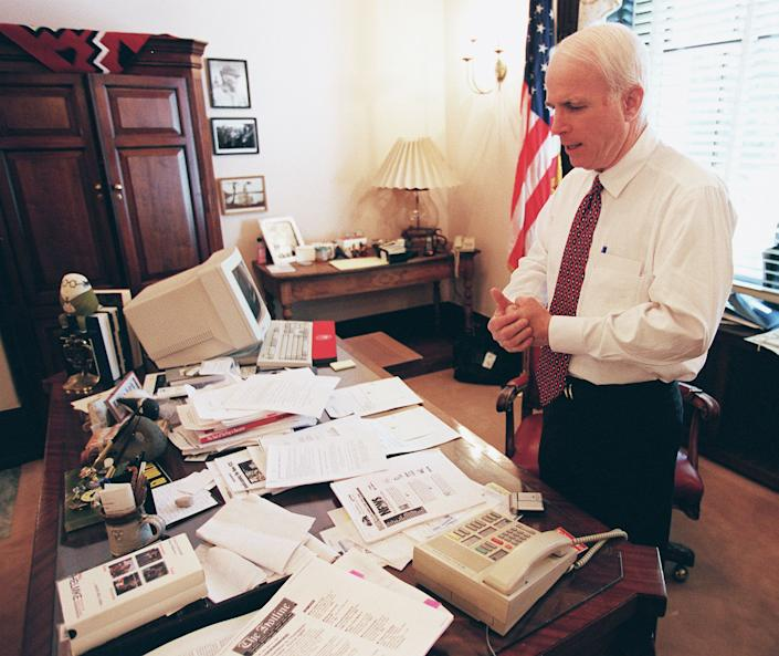 McCain talks to his wife on the speaker phone in his Senate office.