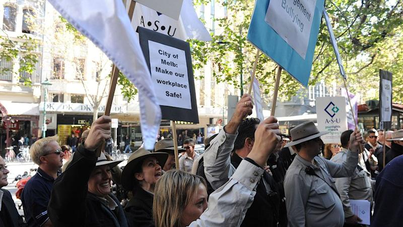 Parking inspectors rallied in Melbourne in 2016, complaining that a local council's revenue raising practices were putting them in danger. Source: AAP