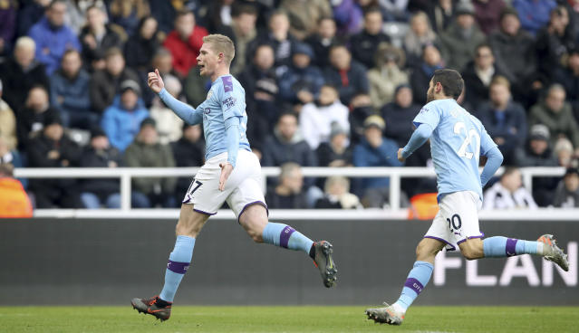 Manchester City's Kevin De Bruyne, left, celebrates scoring his side's second goal of the game during the English Premier League soccer match between Newcastle United and Manchester City at St James' Park, Newcastle, England, Saturday, Nov. 30, 2019. (Owen Humphreys/PA via AP)