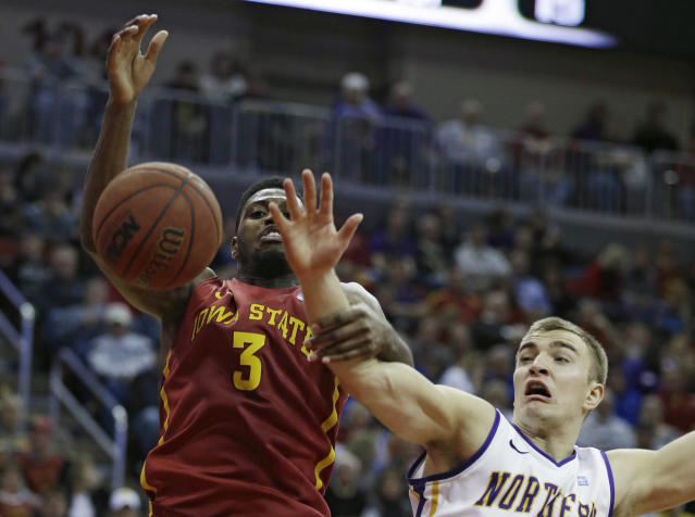Iowa State forward Melvin Ejim, left, fights for a rebound with Northern Iowa forward Chip Rank during the first half of an NCAA college basketball game, Saturday, Dec. 7, 2013, in Des Moines, Iowa. (AP Photo/Charlie Neibergall)