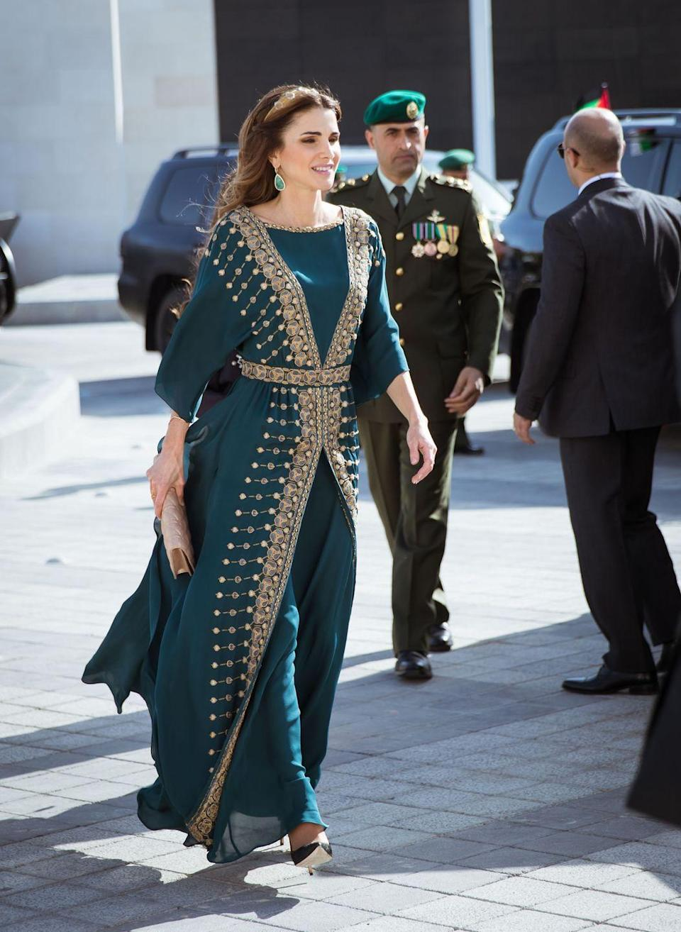 <p>A deep teal chiffon gown and ornamental gold headband helped her ring in the celebration of the centennial of the great Arab revolt earlier this year. </p>