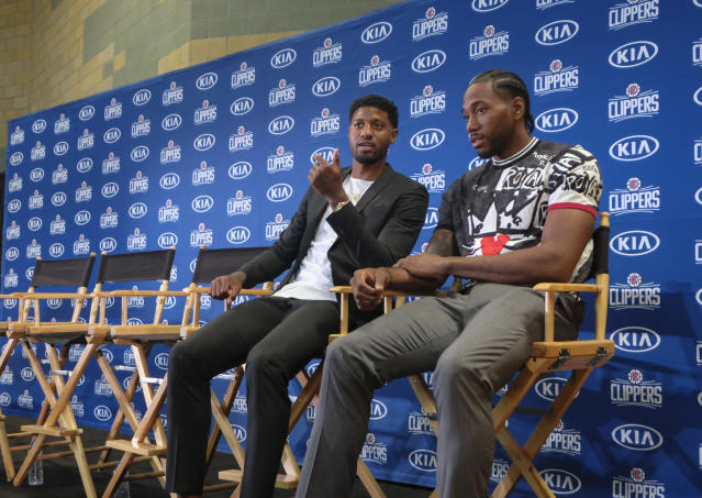 The Paul George-Kawhi Leonard partnership sure did come together quickly — and with George under contract. (AP Photo/Ringo H.W. Chiu)