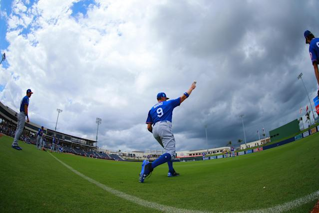 <p>New York Mets outfielder Brandon Nimmo (9) loosens up as storm clouds threaten the baseball game against the Houston Astros at the Ballpark of the Palm Beaches in West Palm Beach, Fla., on Feb. 26, 2018. (Photo: Gordon Donovan/Yahoo News) </p>