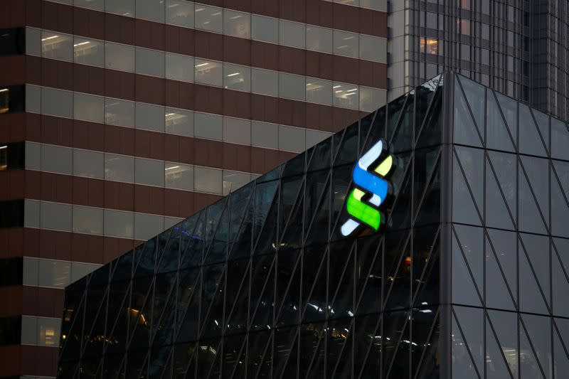 Standard Chartered to streamline business, cut senior roles
