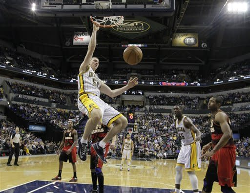 Indiana Pacers' Tyler Hansbrough (50) dunks during the second half of an NBA basketball game against the Atlanta Hawks Monday, March 25, 2013, in Indianapolis. The Pacers defeated the Hawks 100-94. (AP Photo/Darron Cummings)