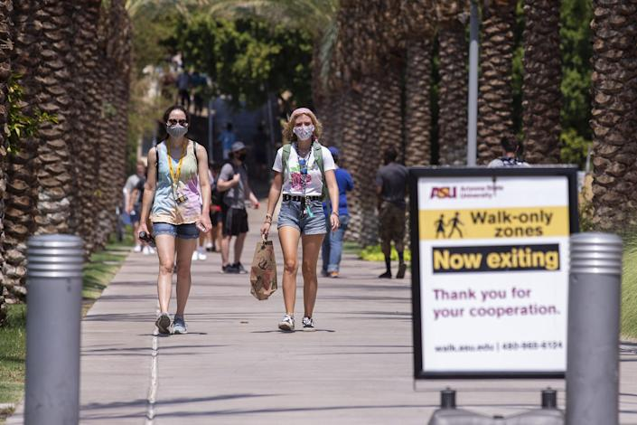 Freshmen Soledad Romero (left) and Addie Ascherl walk on campus the day before school opens on Aug. 19, 2020, at Arizona State University in Tempe.