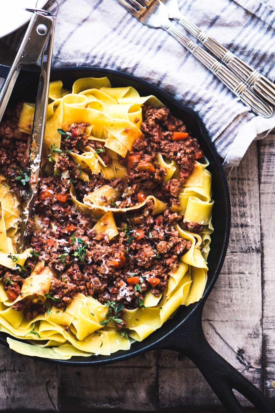 """<p>This classic Italian meat sauce gets even better the longer it cooks. Make a big batch on Sunday and enjoy it all week long. </p><p><strong>Get the recipe at <a href=""""https://theviewfromgreatisland.com/weeknight-dinner-pasta-bolognese/#recipe"""" rel=""""nofollow noopener"""" target=""""_blank"""" data-ylk=""""slk:The View from Great Island"""" class=""""link rapid-noclick-resp"""">The View from Great Island</a>.</strong></p>"""