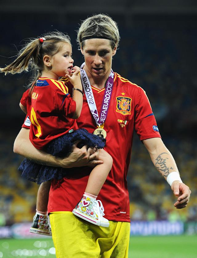 KIEV, UKRAINE - JULY 01: Fernando Torres of Spain speaks with his daughter Nora Torres following victory in the UEFA EURO 2012 final match between Spain and Italy at the Olympic Stadium on July 1, 2012 in Kiev, Ukraine. (Photo by Jasper Juinen/Getty Images)