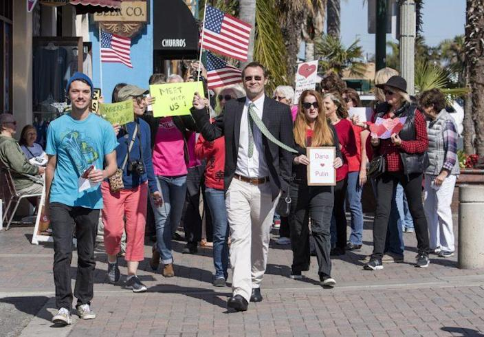 Members of Indivisible OC-48 marched to Rohrabacher's Huntington Beach office on Feb. 14, 2017, to deliver Valentine cards asking him to hold a town hall meeting.