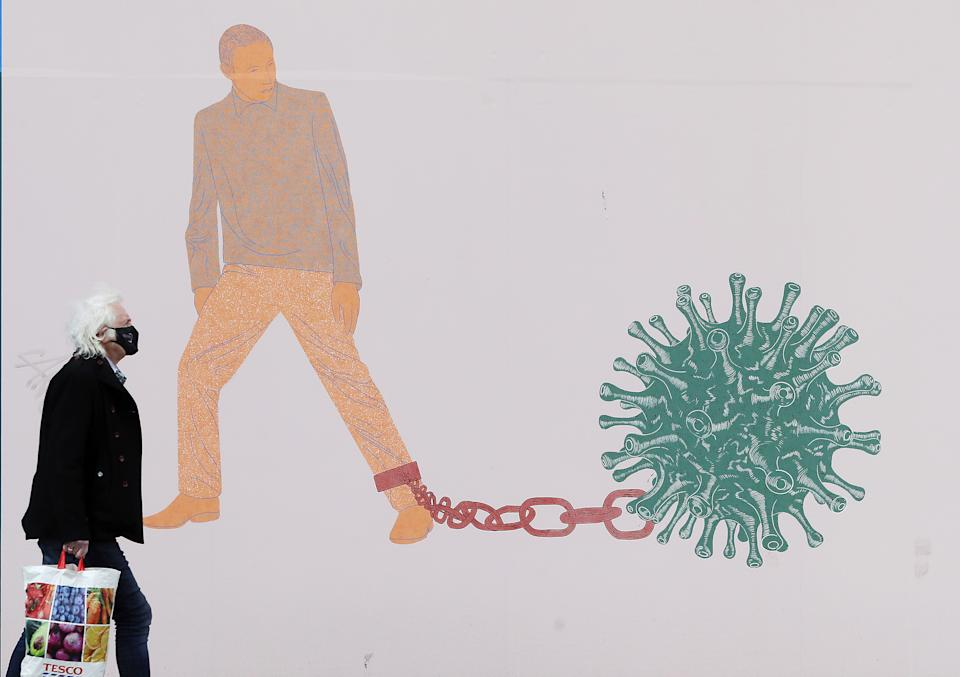 A man walks past part of the 'IN THESE STRANGE TIMES: an evolving series created in response to the pandemic' exhibition at the Science Gallery in Dublin's city centre. There have been four further deaths linked to Covid-19 and an additional 434 confirmed cases, the Department of Health has said. Dr. Holohan has called for caution as the country continues to open up. Picture date: Friday May 7, 2021. See PA story IRISH Coronavirus.
