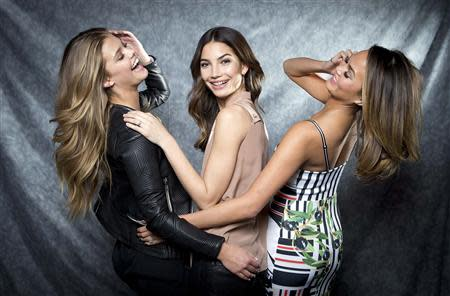 2014 Sports Illustrated cover models Nina Agdal (L), Lily Aldridge and Chrissy Teigen (R) pose for a portrait in New York February 18, 2014. REUTERS/Carlo Allegri