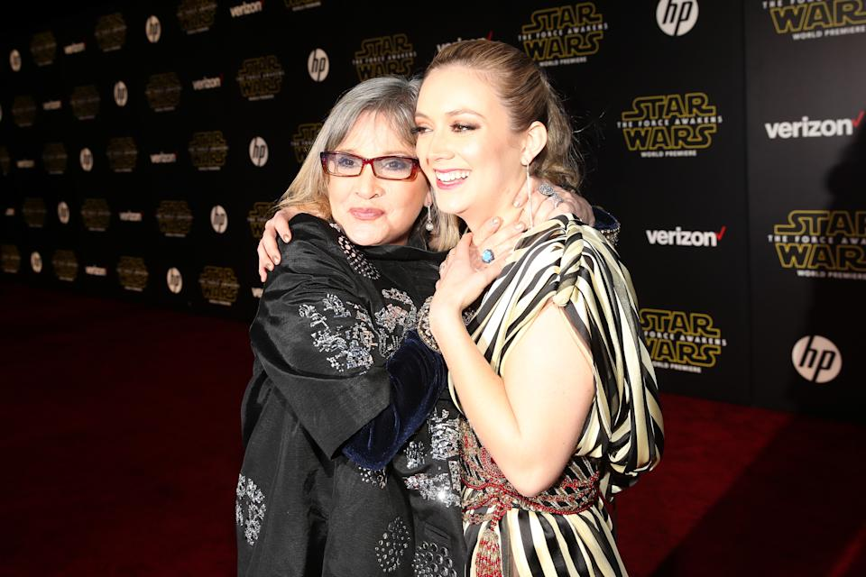 "HOLLYWOOD, CA - DECEMBER 14: Actors Carrie Fisher (L) and Billie Lourd attend the World Premiere of ""Star Wars: The Force Awakens"" at the Dolby, El Capitan, and TCL Theatres on December 14, 2015 in Hollywood, California.  (Photo by Jesse Grant/Getty Images for Disney)"