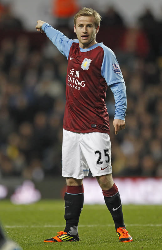 "Aston Villa's Scottish midfielder Barry Bannan gestures during the English Premier League football match between Aston Villa and Arsenal at Villa Park in Birmingham, West Midlands, England on December 21, 2011. RESTRICTED TO EDITORIAL USE. No use with unauthorized audio, video, data, fixture lists, club/league logos or ""live"" services. Online in-match use limited to 45 images, no video emulation. No use in betting, games or single club/league/player publications. (Photo by Ian Kington/AFP/Getty Images)"