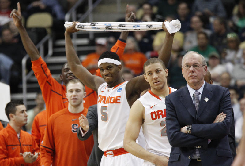 Syracuse head coach Jim Boeheim, right, stands with his team as they start to celebrate as they lead with time running down  in the second half of an East Regional NCAA tournament third-round college basketball game against Kansas State in the NCAA college basketball game on Saturday, March 17, 2012 in Pittsburgh. Syracuse won 75-59. (AP Photo/Keith Srakocic)