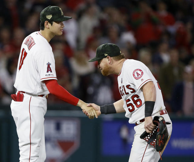 Los Angeles Angels designated hitter Shohei Ohtani, left, and right fielder Kole Calhoun celebrate after the Angels defeated the Kansas City Royals 6-3 in a baseball game in Anaheim, Calif., Saturday, May 18, 2019. (AP Photo/Alex Gallardo)