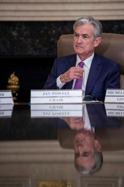 US Federal Reserve Chair Jerome Powell will likely face questions on the economic impact of the virus outbreak in China at his press conference Wednesday (AFP Photo/Eric BARADAT)