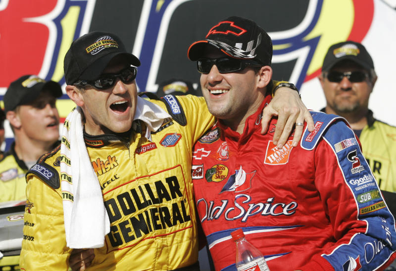 """FILE - In this April 28, 2007, file photo, Bobby Labonte, left, and Tony Stewart, right, celebrate Labonte's win in the NASCAR Busch Series' Aaron's 312 auto race at Talladega Superspeedway in Talladega, Ala. Joe Gibbs, already an NFL Hall of Famer, will be inducted into the NASCAR Hall of Fame alongside Tony Stewart and Bobby Labonte, two drivers who helped him build one of NASCAR's top teams while giving """"Coach Joe"""" three of the organization's five titles. (AP Photo/Rob Carr, File)"""