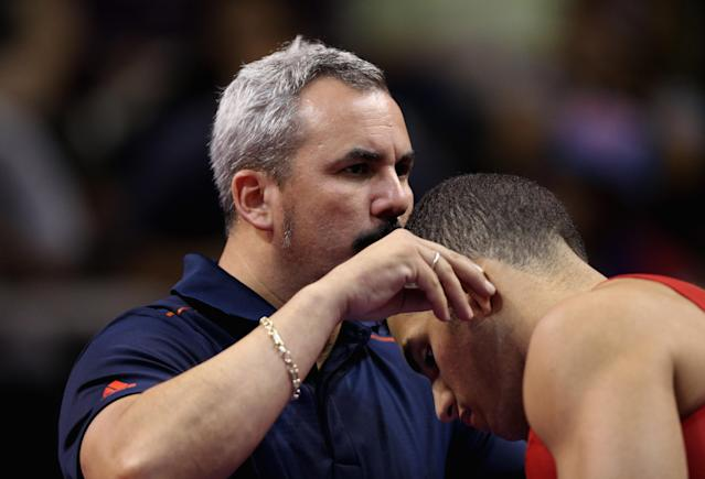 SAN JOSE, CA - JUNE 30: Danell Leyva is kissed by coach Yin Alvarez before competing on the rings on the high bar during day 3 of the 2012 U.S. Olympic Gymnastics Team Trials at HP Pavilion on June 30, 2012 in San Jose, California. (Photo by Ezra Shaw/Getty Images)