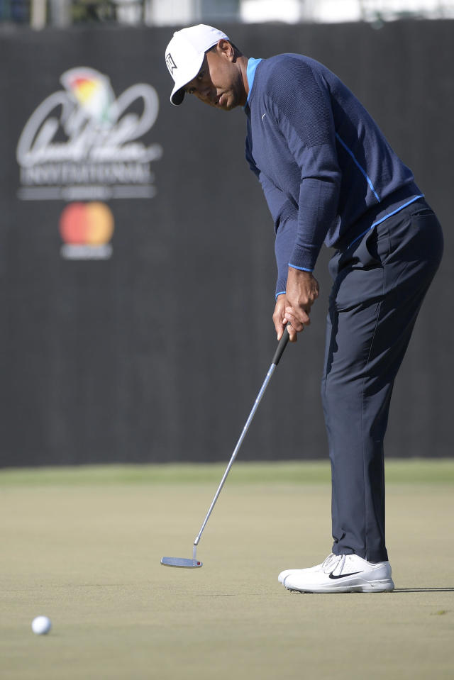 Tiger Woods watches his putt on the 17th green during the first round of the Arnold Palmer Invitational golf tournament Thursday, March 15, 2018, in Orlando, Fla. (AP Photo/Phelan M. Ebenhack)