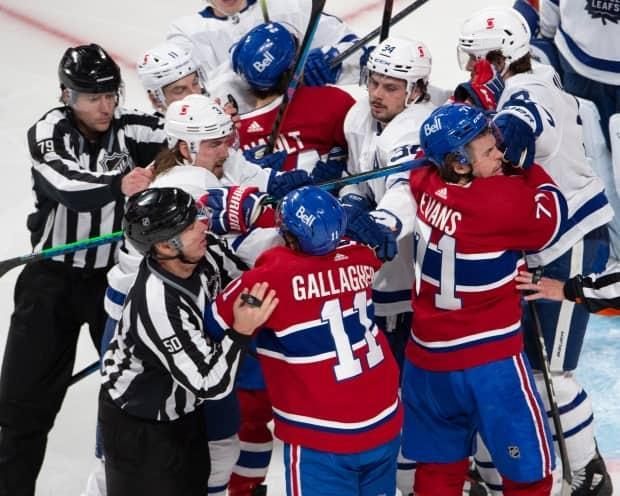 Montreal Canadiens and Toronto Maple Leafs players mix it up after the whistle during the second period of NHL playoff hockey action on Saturday. The federal government is expected to approve an exemption that would allow teams to cross the Canada-U.S. border without mandatory quarantine during playoffs. (Ryan Remiorz/The Canadian Press - image credit)