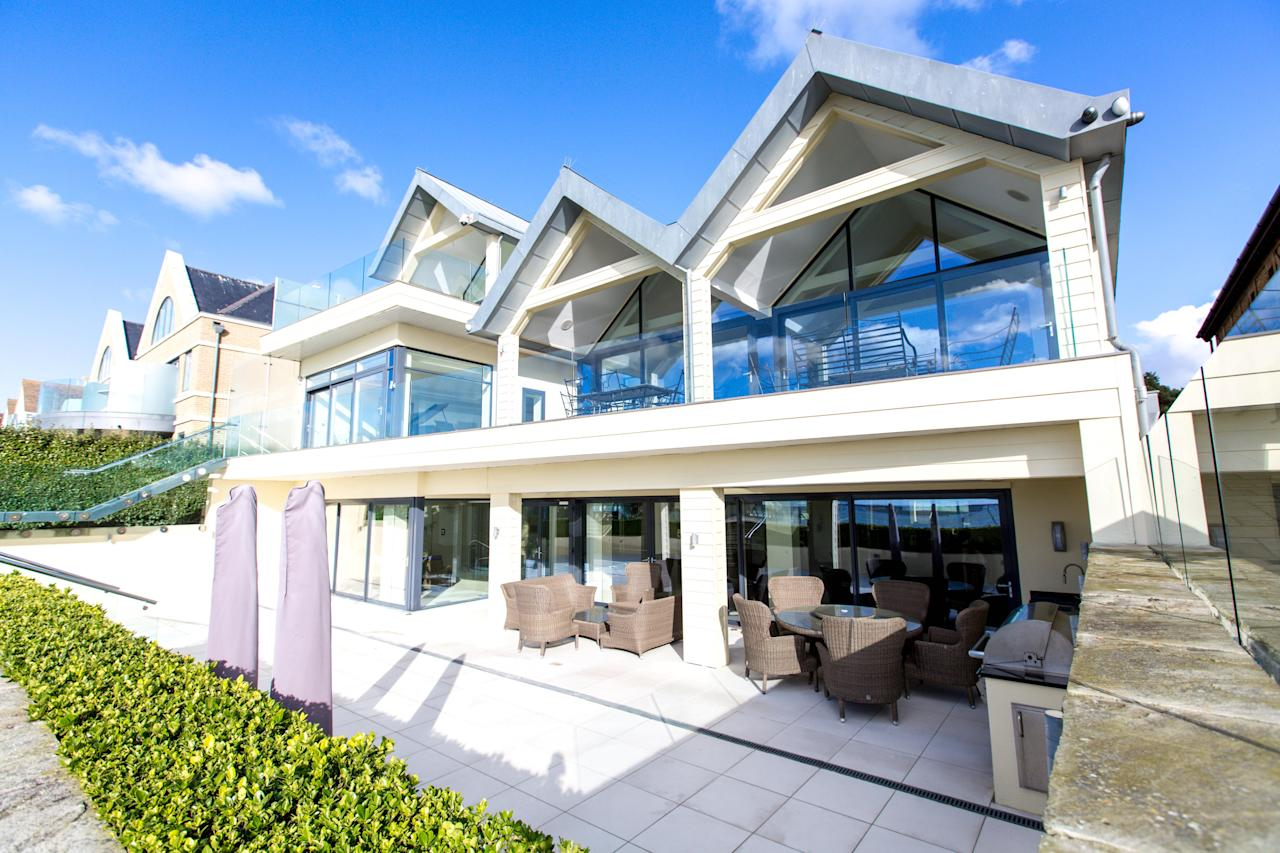 <p>The Moorings on Sandbacks has become one of Britain's most expensive coastal homes after it was sold for a record-breaking £8.09 MILLION. [Picture: SWNS] </p>