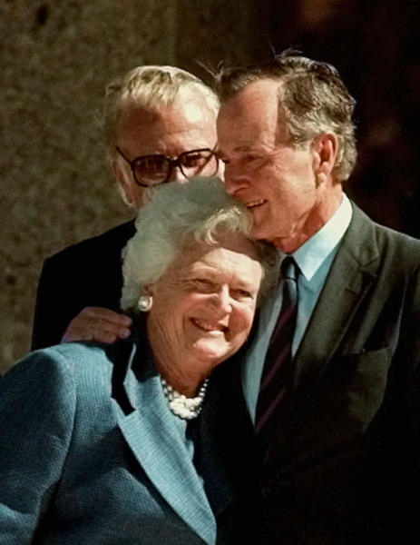 """FILE - In this Nov. 6, 1997, file photo, former President George Bush hugs his wife, Barbara, after his address during the dedication of the George Bush Presidential Library in College Station, Texas. With her husband still at her side, Barbara Bush has decided to decline further medical treatment for health problems and focus instead on """"comfort care"""" at their home in Houston. Family spokesman Jim McGrath disclosed Barbara Bush's decision Sunday, April 15, 2018. (AP Photo/Pat Sullivan, File)"""