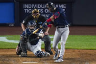 Boston Red Sox's Marwin Gonzalez, right, hits a two-run double during the sixth inning of a baseball game against the New York Yankees, Friday, June 4, 2021, in New York. (AP Photo/Frank Franklin II)