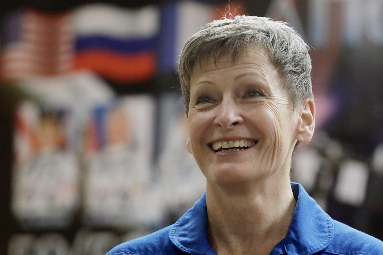 FILE - In this Nov. 16, 2016 file photo, U.S. astronaut Peggy Whitson, a member of the main crew to the International Space Station (ISS), speaks during a news conference in Russian leased Baikonur cosmodrome, Kazakhstan. On Friday, June 15, 2018, NASA announced Whitson, who has spent more time off the planet than any other American, has retired. The 58-year-old biochemist joined NASA as a researcher in 1986 and became an astronaut in 1996. Her last spaceflight was in 2017. (AP Photo/Dmitri Lovetsky)