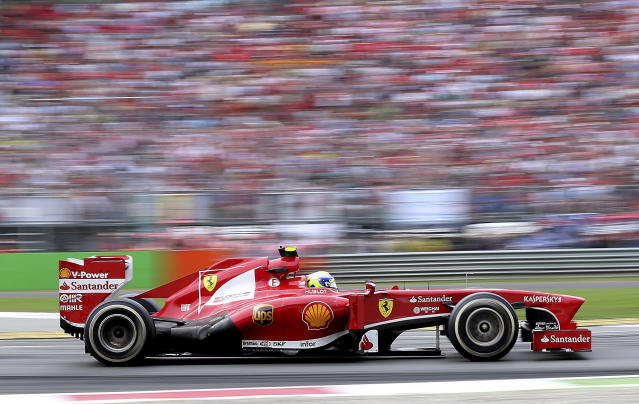 Ferrari driver Felipe Massa, of Brazil, steers his car during the Italian Grand Prix, at the Monza Formula One circuit, in Monza, Italy, Sunday, Sept. 8, 2013. (AP Photo/Antonio Calanni)