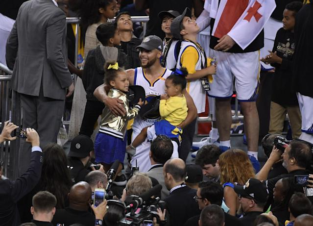 <p>Golden State Warriors guard Stephen Curry with daughters Riley Curry and Ryan Carson Curry after defeating the Cleveland Cavaliers in game five of the 2017 NBA Finals at Oracle Arena. Mandatory Credit: Kyle Terada-USA TODAY Sports </p>