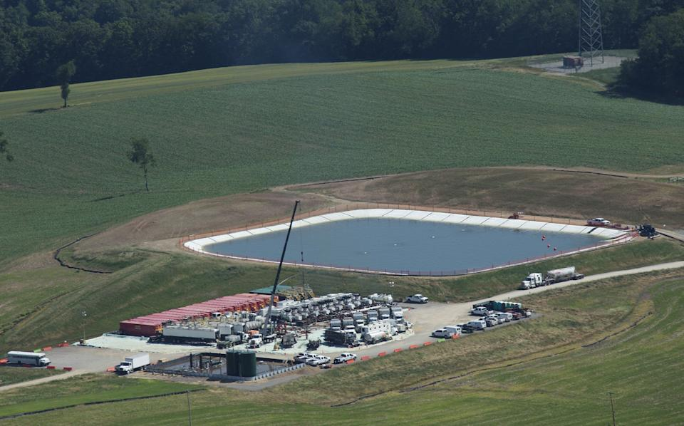 A pit containing fresh water or fresh water with chemicals sits next to a drill site in Butler County, Penn. (Photo: MCT via Getty Images)