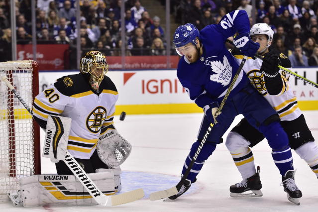 Toronto Maple Leafs right wing William Nylander (29) and Boston Bruins goaltender Tuukka Rask (40) watch the puck as Boston Bruins defenseman Torey Krug (47) defends during the first period of an NHL hockey game, Saturday, Jan. 12, 2019 in Toronto. (Frank Gunn/The Canadian Press via AP)