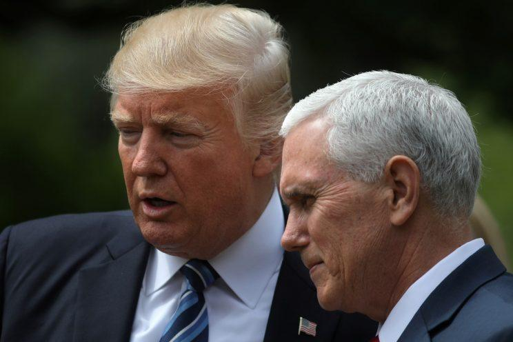 Donald Trump and Mike Pence attend a National Day of Prayer event in the Rose Garden at the White House on May 4, 2017.