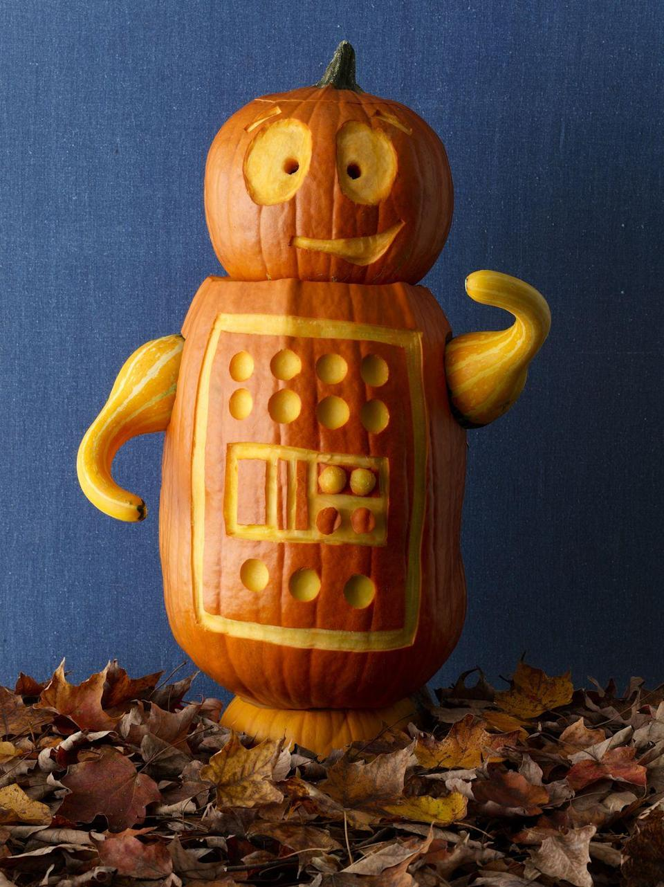 """<p>We can't stop smiling at this little robot. Minimal carving is needed, which is a plus if you want to make more than one. Hint: A melon baller will make creating all those little """"buttons"""" so much easier.</p><p><a href=""""https://www.womansday.com/home/crafts-projects/g950/funny-pumpkin-carving-ideas/?slide=28"""" rel=""""nofollow noopener"""" target=""""_blank"""" data-ylk=""""slk:Get the tutorial at Woman's Day »"""" class=""""link rapid-noclick-resp""""><em>Get the tutorial at Woman's Day »</em> </a></p>"""