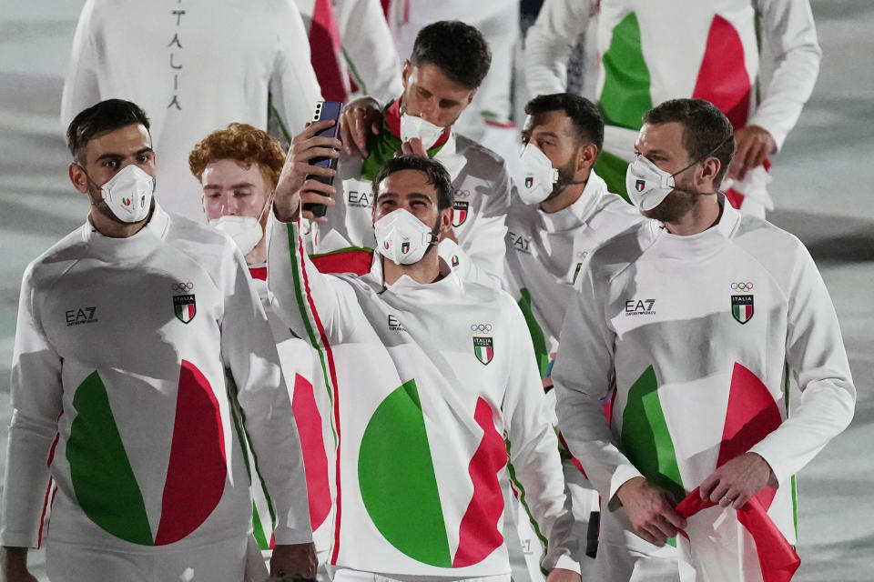 Athletes from Italy march during the opening ceremony in the 2020 Summer Olympics. - Credit: AP