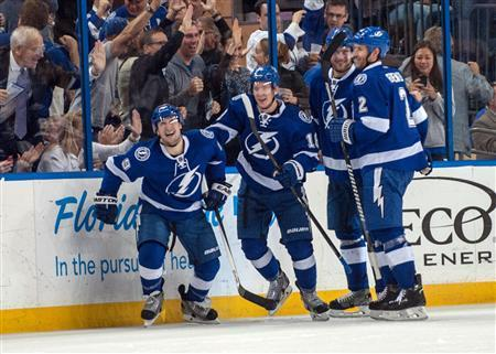 Apr 1, 2014; Tampa, FL, USA; Tampa Bay Lightning defenseman Eric Brewer (2) celebrates scoring a goal with right wing Teddy Purcell (16), right wing Richard Panik (71) and defenseman Eric Brewer (2) at Tampa Bay Times Forum. Mandatory Credit: Jeff Griffith-USA TODAY Sports