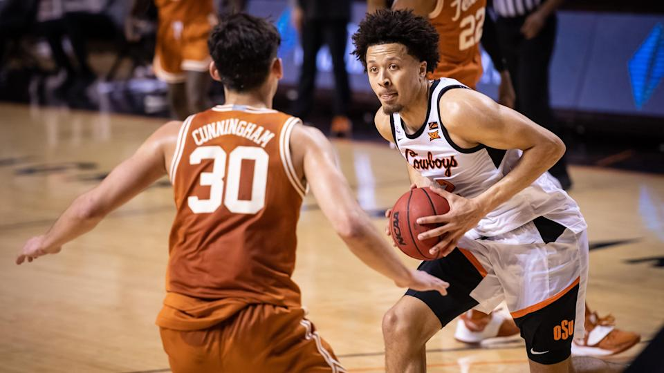 Oklahoma State Cowboys guard Cade Cunningham (2) drives to the basket while defended by Texas Longhorns forward Brock Cunningham (30) during the first OT at Gallagher-Iba Arena.