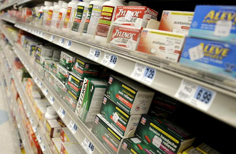This photo taken March 10, 2013 shows non-prescription drugs displayed at a pharmacy in New York. Nearly every woman takes a medication at some point during pregnancy. Yet there's disturbingly little easy-to-understand information about which drugs pose a risk to her baby, and what to do about it.  (AP Photo/Seth Wenig)