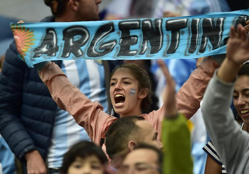 A supporter of Argentina cheers before the start of the FIFA 2018 World Cup qualifier match against Ecuador, in Quito, on October 10, 2017 (AFP Photo/Rodrigo BUENDIA )
