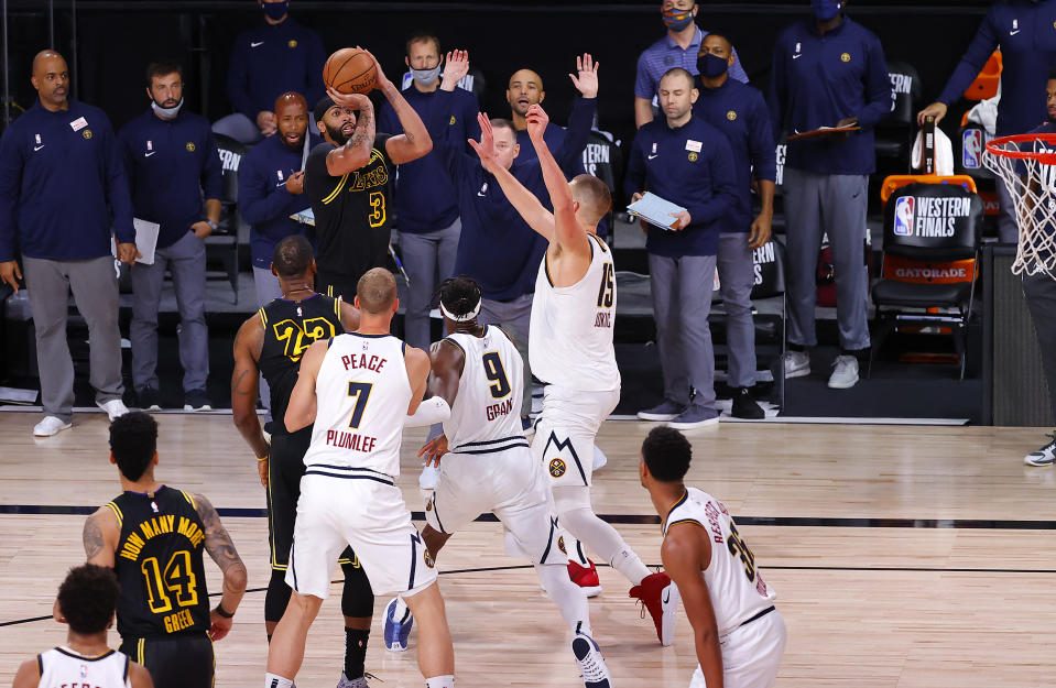 LAKE BUENA VISTA, FLORIDA - SEPTEMBER 20: Anthony Davis #3 of the Los Angeles Lakers shoots a three point basket to win the game over Denver Nuggets in Game Two of the Western Conference Finals during the 2020 NBA Playoffs at AdventHealth Arena at the ESPN Wide World Of Sports Complex on September 20, 2020 in Lake Buena Vista, Florida. NOTE TO USER: User expressly acknowledges and agrees that, by downloading and or using this photograph, User is consenting to the terms and conditions of the Getty Images License Agreement. (Photo by Kevin C. Cox/Getty Images)