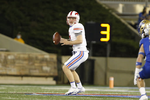 SMU quarterback Shane Buechele (7) drops back to pass against Tulsa during the first half of an NCAA college football game in Tulsa, Okla., Saturday, Nov. 14, 2020. (AP Photo/Joey Johnson)