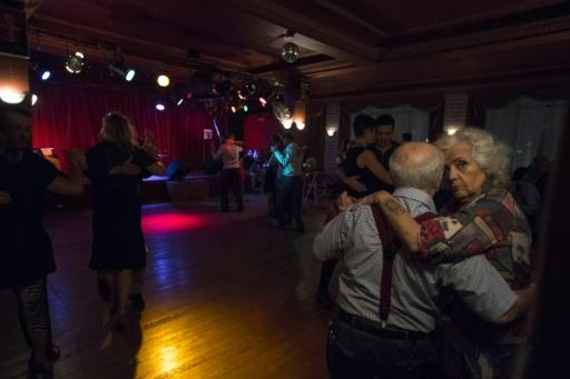 A couple dances tango at Chamuyo milonga in Montevideo