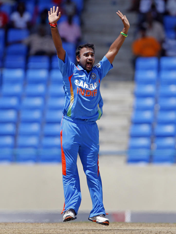 India's bowler Amit Mishra successfully appeals for the LBW of West Indies' Marlon Samuels, to dismiss him for 8 runs, during their fourth one-day international cricket match in St. John's, Antigua, Monday June 13, 2011. (AP Photo/Andres Leighton)